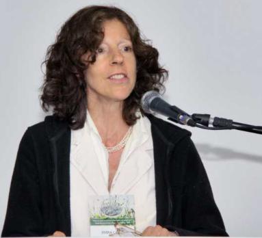 Photo of Joanna Campe speaking behind a podium.